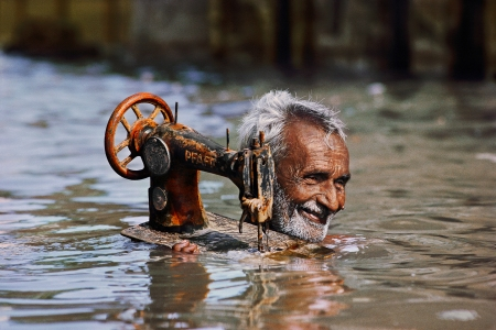"Steve McCurry:""Tailor in Monsoon"", Porbandar, India, 1983"